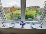 Double Bedroom 1 with south facing views over the spacious garden towards the Cheviot Hills