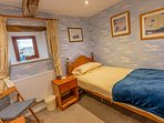 The 3rd bedroom is a single with a small cottage window overlooking the valley....