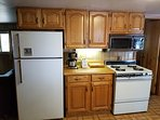 KITCHEN ,REFRIGERATOR, COFFEE MAKER, TOASTER, MICROWAVE,AND OVEN