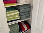 Linen closet offers guests plenty of bath and beach towels
