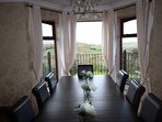 Dining Room with views and double doors to balcony