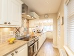 Beautiful kitchen with all mod cons including a large range oven