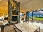 Formal Lounge with feature schist fireplace and great views