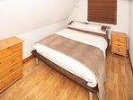 Generous sized bedroom with large double bed and individually controlled electric blanket
