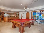 Billiard Table on the lower level with the pool just a few steps away!