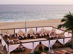 Add a wooden platform on the beach for dining & dancing!