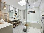 Ground floor bathroom with jacuzzi bathtub and shower cabin.