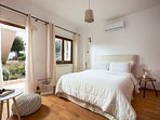Ground floor bedroom with double bed and direct access to the garden.