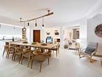 Spacious open plan area consisting of the living room, dining and kitchen.