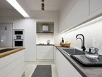 Fully equipped kitchen with top quality fixtures and appliances.