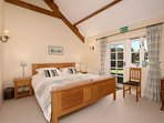 Bedroom 1 ensuite with huge superking bed, TV and ensuite.  Direct access to garden.