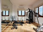 The gym room offers a collection of fitness equipment.