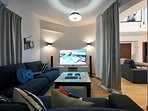 """Cinema room with ultra 65"""" HDTV with Netflix and Playstation 4 with games."""