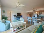 Spacious and bright aquamarine living room with large TV