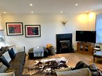 """Open plan downstairs living space with 50"""" smart Tv and log burner"""