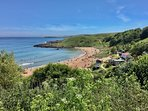 Coldingham Bay in Summer with life guards and beach cafe