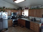 Large kitchen, double oven, dishwasher, full use of empty refrigerator and freezer