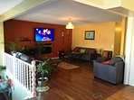 open concept 65' TV and comfy for family cozy memories