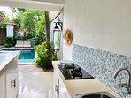 Kitchen, full fridge, gas cook top, cooking equipment, basic ingredients