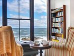Read a book and gaze out over the ocean