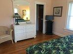 Master bedroom through to en suite bathroom