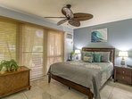 Master bedroom features a queen sized bed.