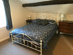 Double bed within the triple bedroom