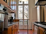 The fully-equipped kitchen overlooking a leafy garden...