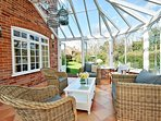 The light filled conservatory leads onto the garden.