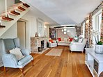 Spacious sitting room with open fire and comfortable chairs to enjoy with a good book.