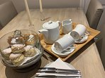 Complimentary afternoon tea with fresh clotted cream scones on arrival