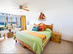 Master bedroom looks out on the Caribbean.