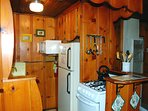 Fully equipped kitchen (refrigerator with freezer, gas stove with oven, microwave, toaster, regular coffee maker...