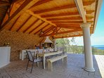 Fully equipped BBQ area for guests' enjoyment. Enjoy your meal by the adjoining pool.