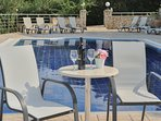 Enjoy a cool glass of wine after your dip in the pool.