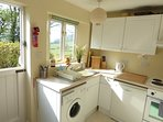 Kitchen, showing washing machine, dishwasher, oven, hob, views.