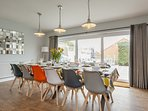 Dining table with views to the garden and seating for up to 14 guests