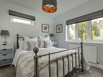 Gresham: a ground floor bedroom with a king size bed and a spacious en-suite bathroom.