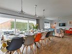 The open plan dining and living areas with folding doors to the garden
