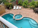 View over pool, spa and garden from balcony of upper master suite