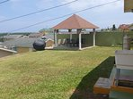 Gazebo and BBQ grill at back of house. Falmouth Cruise Ship Port can be seen from gazebo.
