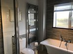 Ground floor family bathroom with free standing bath and large separate shower
