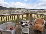 Relax on the raised deck with steps to private garden.