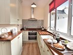 Well equipped kitchen with built in appliances.