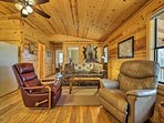 The living room offers plenty of seating for your whole crew.