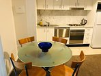 Dinning table for 4 people. Full kitchen with plenty of pots and pans.