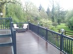 Decking area around pool with a view of the garden.