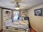 The second bedroom features a cozy full-sized bed.