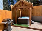 Enjoy the yard with Jacuzzi, BBQ, seating and play area