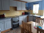 Fully fitted kitchen with washing machine, full sized fridge freezer and dishwasher.